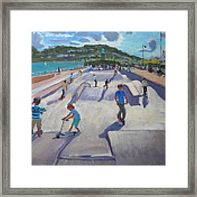 Skateboaders  Teignmouth Framed Print by Andrew Macara