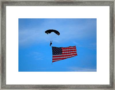 A Skydiver With An American Flag  Framed Print by Art Spectrum