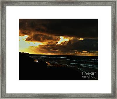 A Stormy Sunrise Framed Print