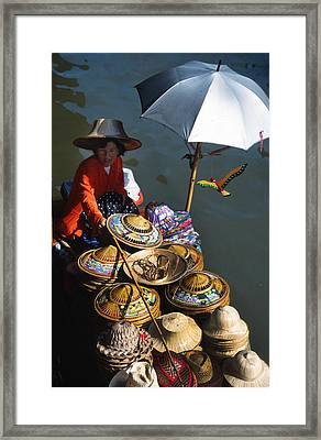 Boat Woman In Thailand Framed Print by Carl Purcell