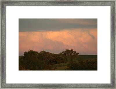 Clouds Of A Distant Storm Framed Print by Linda Ostby