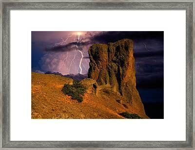 Lightning Over The Cliff  Framed Print by Yuri Hope