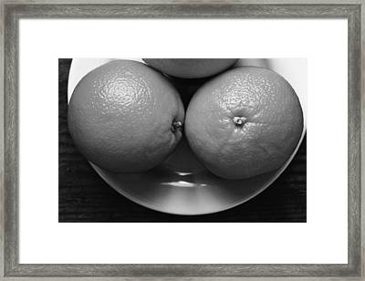 Oranges On White Plate In Black And White Framed Print by Donald Erickson