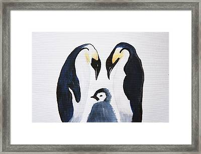 Penguins With Chick  Framed Print by Art Spectrum