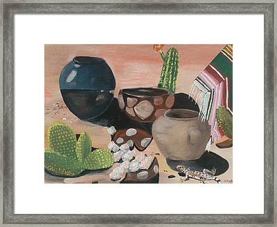 Pottery In The Desert Framed Print