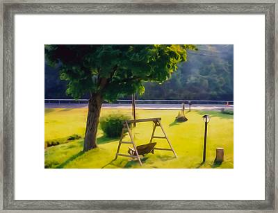 Wooden Swing In The Garden Framed Print by Lanjee Chee