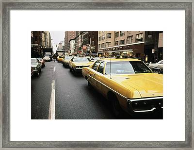 1970s America. Yellow Taxi Cabs Framed Print by Everett