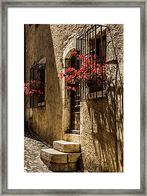 A Barred Window And Door With Red Begonia And Contrasty Shadows Saint Paul De Vence France Framed Print