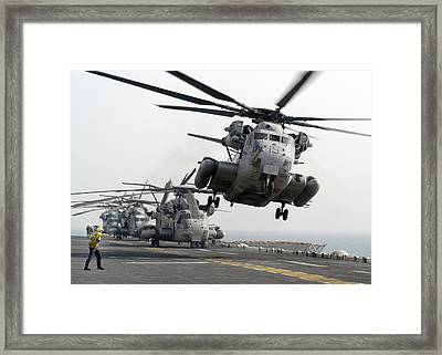 A Ch-53e Super Stallion Lifts Framed Print by Stocktrek Images