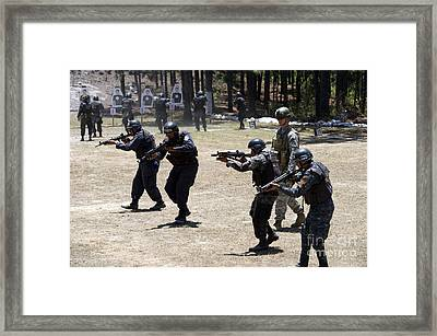 A Green Beret Walks With Tigres Framed Print by Stocktrek Images