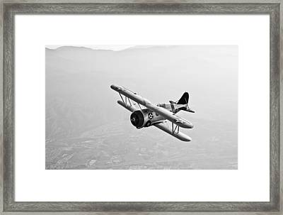A Grumman F3f Biplane In Flight Framed Print by Scott Germain
