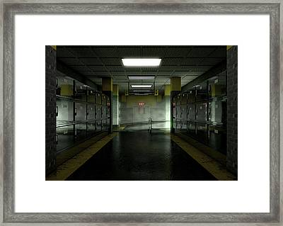 A Look Down The Aisle Of Fridges Of A Dimly Lit Ward In A Mortuary With An Empty Gerney In The Dista Framed Print