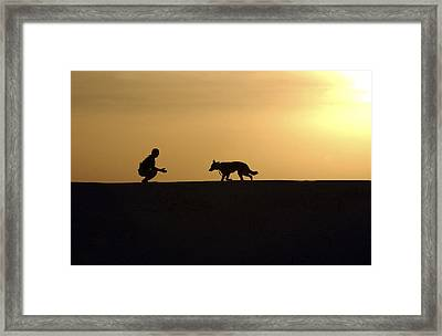 A Military Working Dog And His Handler Framed Print by Stocktrek Images
