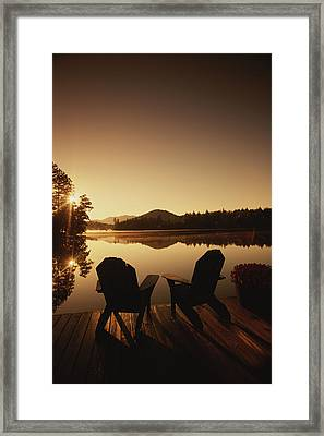 A Pair Of Adirondack Chairs On A Dock Framed Print