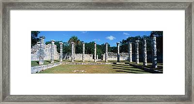 A Panoramic View Of Columns Surround Framed Print