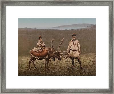 A Sami Man And Child In Finnmark Framed Print