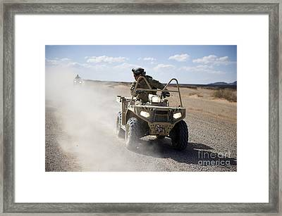 A U.s. Soldier Performs Off-road Framed Print by Stocktrek Images