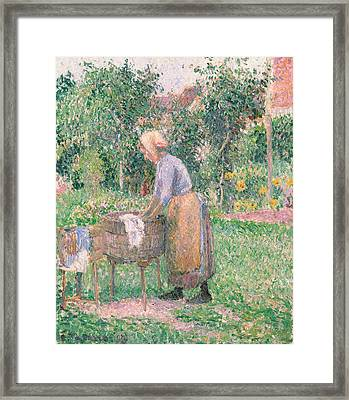 A Washerwoman At Eragny Framed Print by Camille Pissarro
