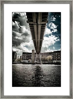 A Water Skier Speeds Past The Royal Victoria Dock Bridge Framed Print
