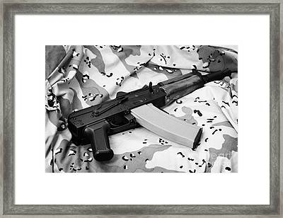 Ak-47u On Old Persian Gulf War Desert Battle Dress Uniform Framed Print by Joe Fox