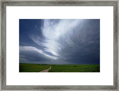 An Afternoon Thunderstorm Coming Framed Print by Jim Richardson