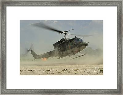 An Agusta Bell Ab 212 Of The Italian Framed Print by Remo Guidi