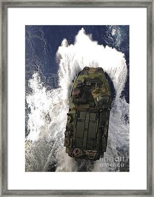 An Amphibious Assault Vehicle Exits Framed Print by Stocktrek Images