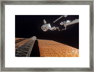 An Astronaut Anchored To A Foot Framed Print