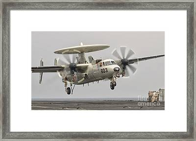 An E-2c Hawkeye Landing On The Flight Framed Print by Giovanni Colla
