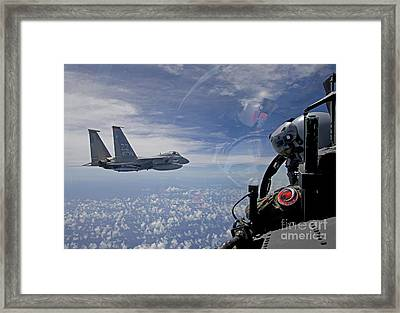An F-15 Eagle Pilot Flies In Formation Framed Print