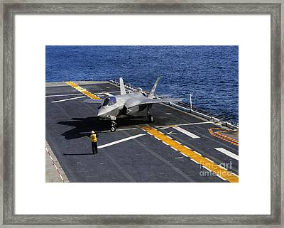 An F-35b Lightning II Makes A Vertical Framed Print by Stocktrek Images