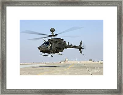 An Oh-58d Kiowa Warrior Hovers Framed Print