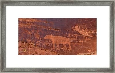 Ancient Native American Petroglyphs On A Canyon Wall Near Moab. Framed Print