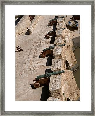 Antique Cannon Lined Up On The City Framed Print