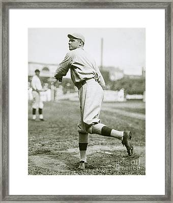 Babe Ruth Pitching Framed Print by Jon Neidert