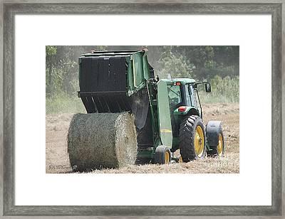 Baling Hay Framed Print by J McCombie