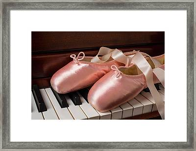 Ballet Shoes On Piano Keys Framed Print