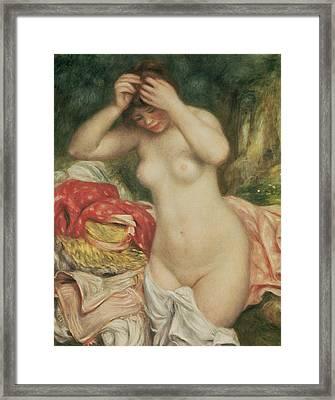 Bather Arranging Her Hair Framed Print by Pierre Auguste Renoir