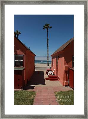 Beach Cottages Framed Print by Kim Pascu