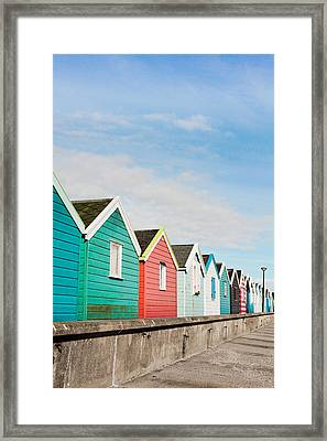 Beach Huts Framed Print by Tom Gowanlock
