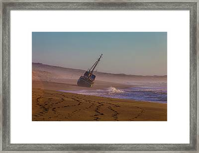 Beached Boat Framed Print by Garry Gay
