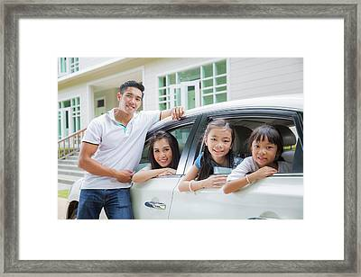 Beautiful Family Portrait Smiling Outside Their New House  Framed Print by Anek Suwannaphoom