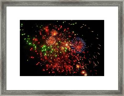 Beautiful Fireworks Against The Black Sky Of The New Year Framed Print