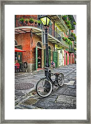 Bike And Lamppost In Pirate's Alley Framed Print by Kathleen K Parker