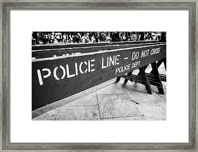blue wooden police line do not cross nypd crowd traffic barrier New York City USA Framed Print