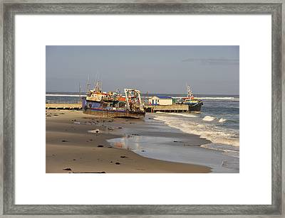 Boats Aground Framed Print by Patrick Kain