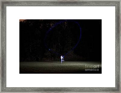Boomerang At Night Framed Print by Ted Kinsman