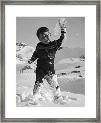 Boy Throwing A Snowball Framed Print by German School