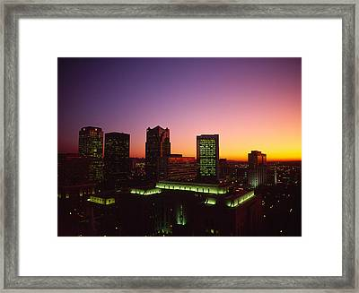 Buildings In A City At Dusk Framed Print