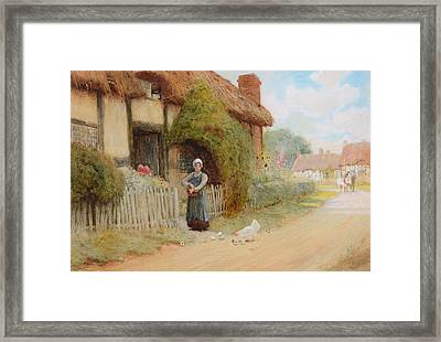 By A Cottage Framed Print